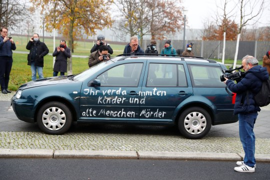 Media films and photograph the car which crashed into the gate of the main entrance of the chancellery in Berlin, the office of German Chancellor Angela Merkel in Berlin, Germany, November 25, 2020. REUTERS/Fabrizio Bensch