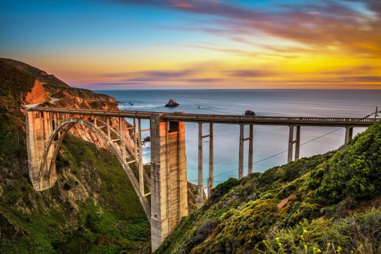 Bixby Bridge (Rocky Creek Bridge) and Pacific Coast Highway at sunset near Big Sur in California, USA.