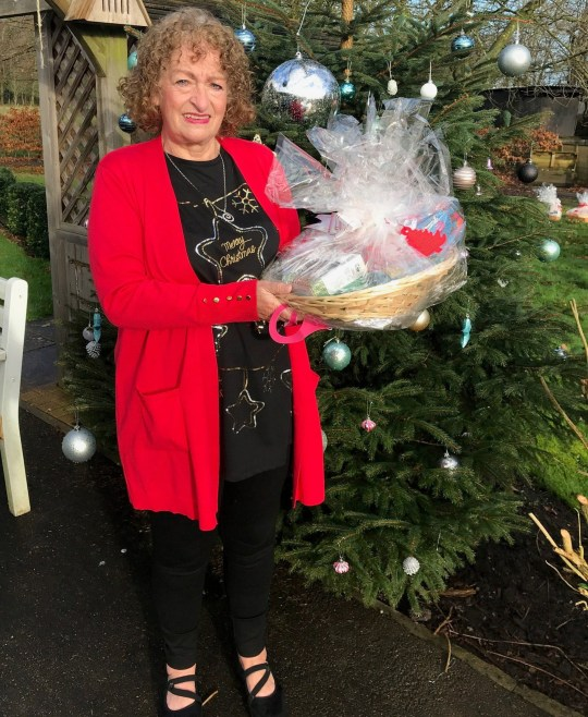 Carer Norma Kirby at Charnley Fold Day Centre in Bamber Bridge near Preston with a Christmas hamper delivered by Lottery winner Natalie Cunliffe.