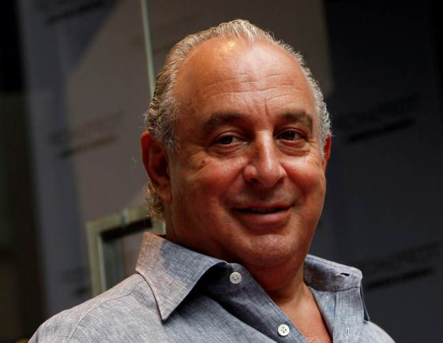 FILE PHOTO: British billionaire and CEO of the Arcadia Group Philip Green smiles as he attends the opening ceremony of a Topshop flagship store in Hong Kong June 6, 2013. REUTERS/Bobby Yip/File Photo