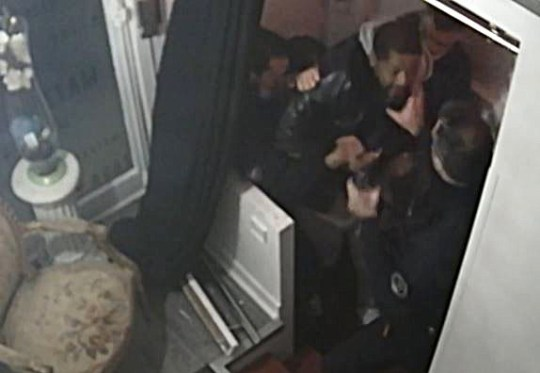 This video grab taken on November 27, 2020 from an AFP video shows CCTV camera footage, widely distributed on social networks, shows producer Michel Zecler being beaten up by police officers at the entrance of a music studio in the 17th arrondissement of Paris on November 21, 2020. - Four French police officers were detained for questioning on November 27, 2020 after a video showed them beating up a black music producer in Paris, sparking outrage from the government and celebrities, a source close to the case told AFP. The officers, who have been suspended from duty, were being held at the National Police Inspectorate General (IGPN), and prosecutors opened an investigation into violence by a person in authority and false testimony, the source said. (Photo by Stefano RELLANDINI / AFP) (Photo by STEFANO RELLANDINI/AFP via Getty Images)