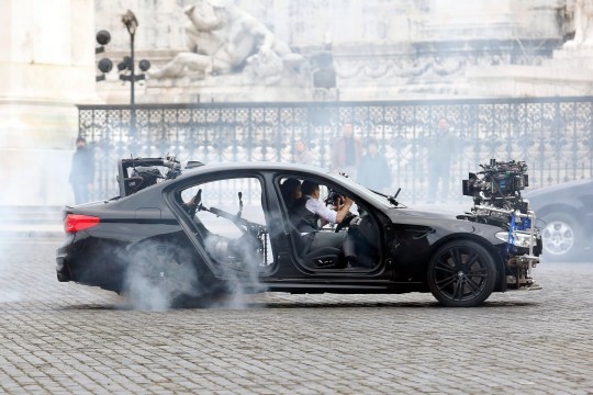 SIPA USA via PA Images Actor Tom Cruise and actress Hayley Atwell handcuffed together filming a thrilling chase with cars on the set of the film Mission Impossible 7 in Piazza Venezia, just in front of the Victor Emmanuel II Monument (Tomb of the Unknown Soldier). Rome (Italy), November 29th 2020 Photo Samantha Zucchi /Insidefoto/Sipa USA)