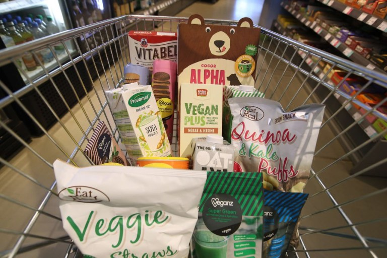 BERLIN, GERMANY - FEBRUARY 02: A grocery cart filled by the photographer with vegan food products stands in a Veganz vegan grocery store on February 2, 2018 in Berlin, Germany. Veganz has three stores in Berlin and sells a wide range of vegan foods. Vegan food offerings are a growing trend in Berlin with more and more restaurants and shops specializing in purely plant-based products as an alternative to conventional meat or dairy-based foods. (Photo by Sean Gallup/Getty Images)