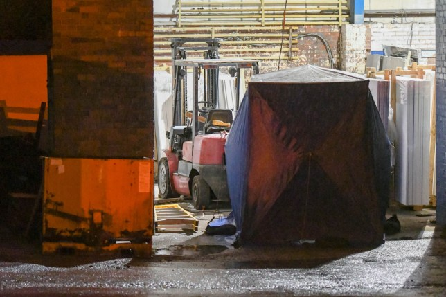 A man in his 40s has been killed after granite slabs fell on top of him at a kitchen workshop in Halesowen, in the West Midlands.