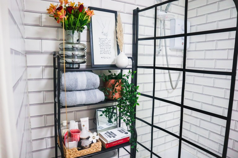 What I Rent: Beverley, £450 a month for a one-bedroom flat in Leeds - the bathroom with shelves: towels, plant, and perfumes