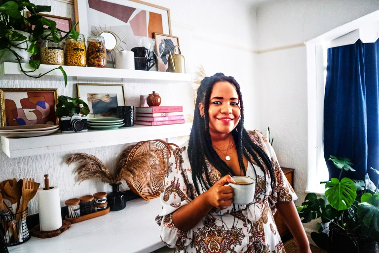 What I Rent: Beverley, £450 a month for a one-bedroom flat in Leeds - Beverley next to her kitchen shelves
