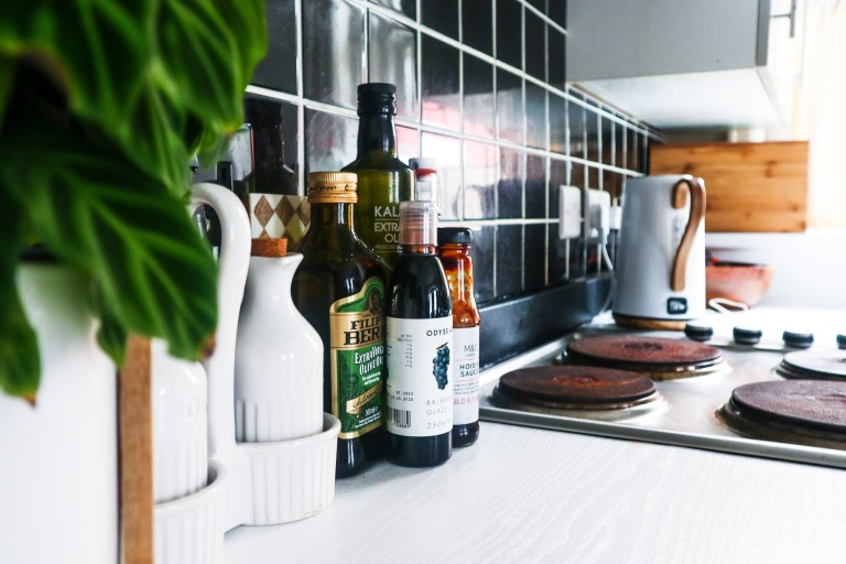 bottles of olive oil and a kettle in beverley's kitchen