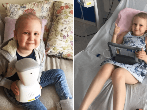 Seven-year-old girl with cancer goes to school from her hospital bed using a robot