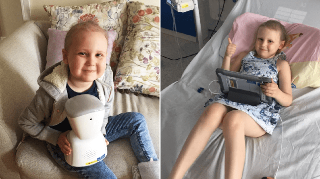 Seren Mawson, seven, using her robot which allows her to attend school from her hospital bed