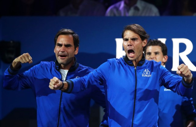 Rafael Nadal of Team Europe and teammate Roger Federer celebrate during the singles match between Stefanos Tsitsipas of Team Europe and Taylor Fritz of Team World during Day One of the Laver Cup 2019 at Palexpo on September 20, 2019 in Geneva, Switzerland. The Laver Cup will see six players from the rest of the World competing against their counterparts from Europe. Team World is captained by John McEnroe and Team Europe is captained by Bjorn Borg. The tournament runs from September 20-22.