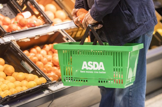 Person holding Asda shopping basket