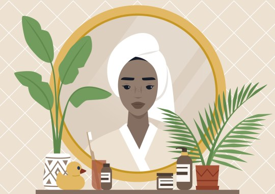A mirror reflection, a Young black female character wearing a towel wrapped at the side of their head, daily body care routine, boho interior, natural patterns and plants
