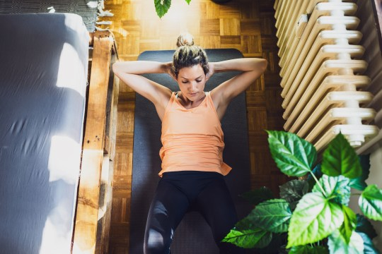 Woman doing crunches at home workout