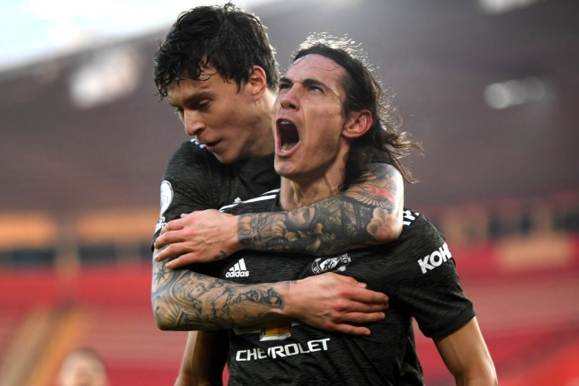 Edinson Cavani (R) of Manchester United celebrates with team mate Victor Lindelof after scoring their sides second goal during the Premier League match between Southampton and Manchester United at St Mary's Stadium on November 29, 2020 in Southampton, England. Sporting stadiums around the UK remain under strict restrictions due to the Coronavirus Pandemic as Government social distancing laws prohibit fans inside venues resulting in games being played behind closed doors.