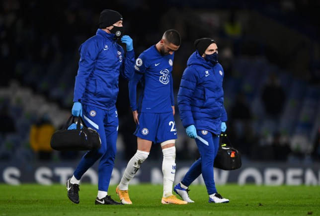 Hakim Ziyech feels his hamstring after being forced off in Chelsea's Premier League clash with Leeds United