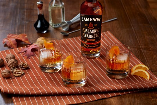 a bottle of Jameson Black Barrel next to a cocktail