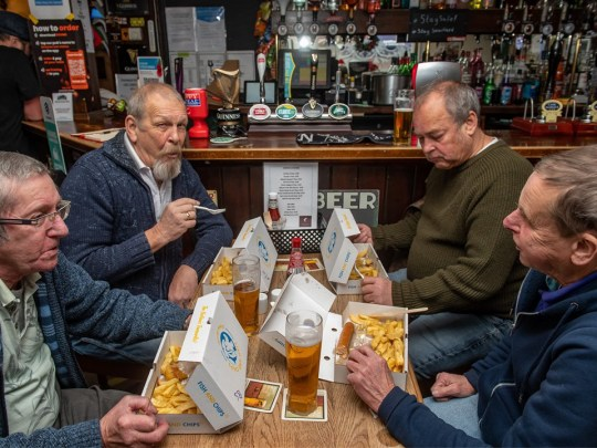Drinkers enjoy fish and chips with a pint as pubs reopen again