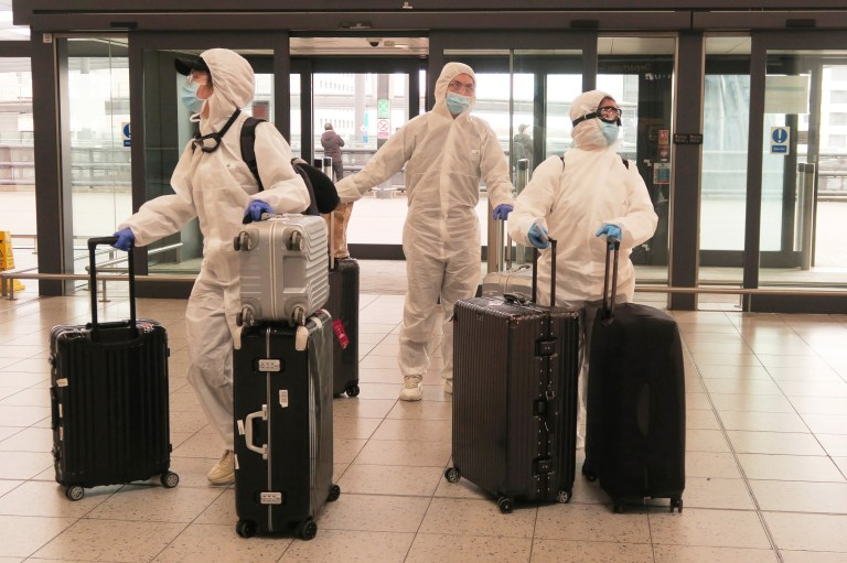 European Best Pictures Of The Day - March 17 - LONDON, UNITED KINGDOM - MARCH 17: Passengers determined to avoid the coronavirus before leaving the UK arrive at Gatwick Airport on March 17, 2020 in Gatwick, United Kingdom. Several UK and European carriers are reducing staff and practically grounding their fleets as governments worldwide impose travel restrictions to curb the spread of COVID-19. (Photo by Mike Hewitt/Getty Images)