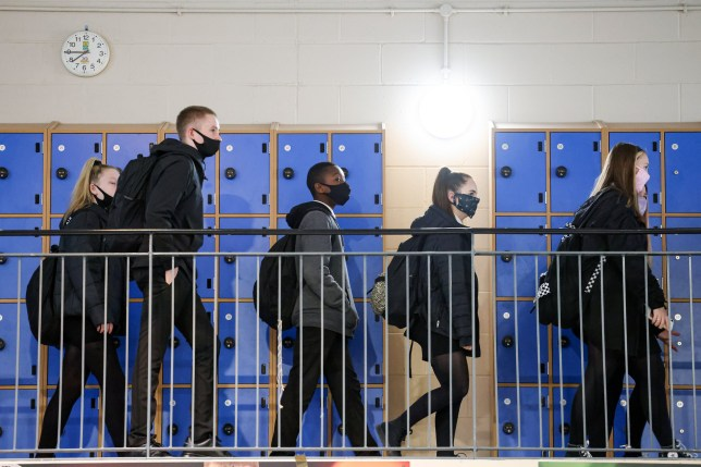 Pupils at Rosshall Academy wear face coverings as it becomes mandatory in corridors and communal areas on August 31, 2020 in Glasgow, Scotland.