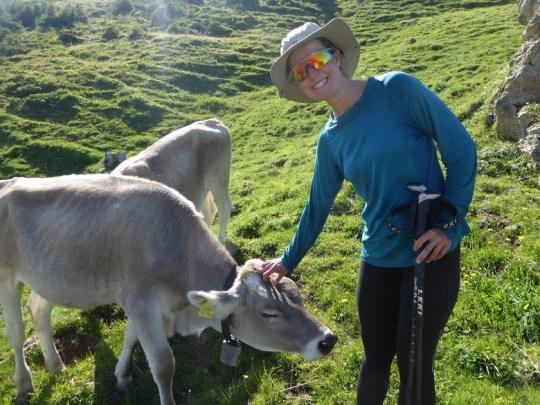 Esther Dingley stroking a cow