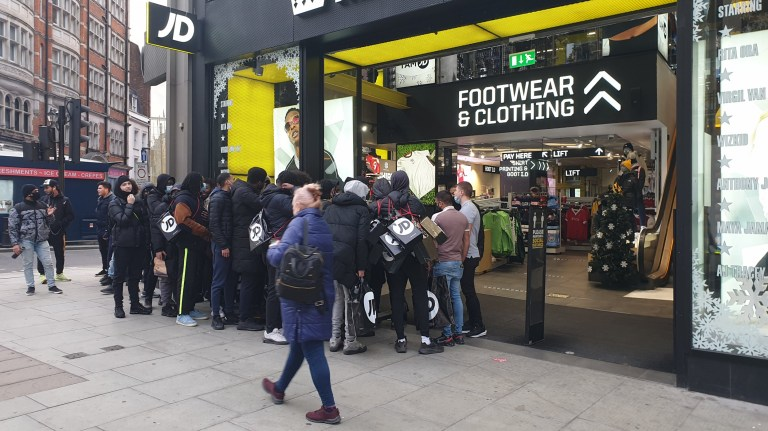 w8media People waiting to get into j d sports on Oxford street, london