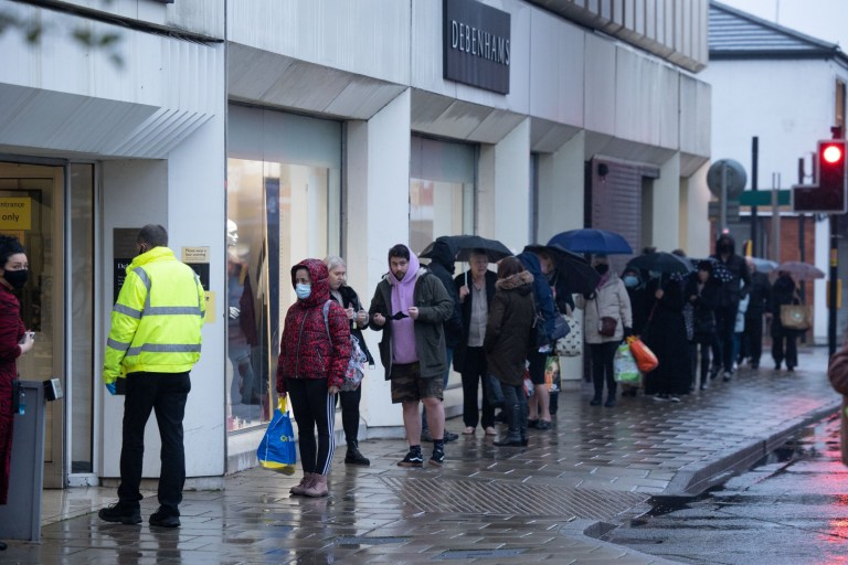 Shoppers outside Debenhams in Stockport, as the retailer holds a fire sale with up to 70% off goods, as Arcadia is put into administration (Wednesday 2nd December 2020). Disclaimer: While Cavendish Press (Manchester) Ltd uses its' best endeavours to establish the copyright and authenticity of all pictures supplied, it accepts no liability for any damage, loss or legal action caused by the use of images supplied. The publication of images is solely at your discretion. For terms and conditions see http://www.cavendish-press.co.uk/pages/terms-and-conditions.aspx