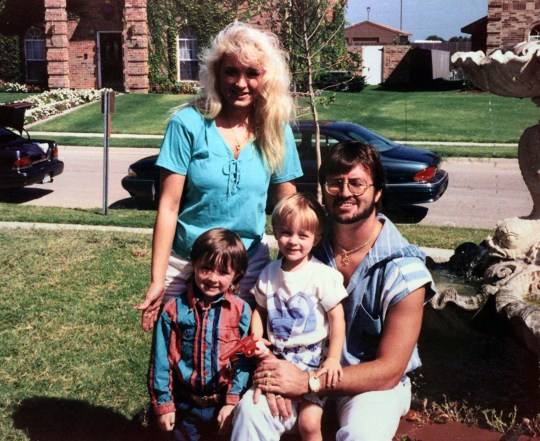 Darlie Routier, standing, poses with her husband Darin and two sons Damon, left, and Devon in this 1993 family photo at their Rowlett, Texas, home.