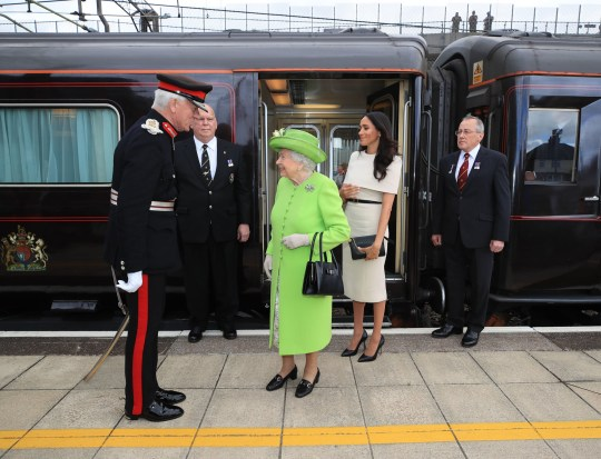 EMBARGOED TO 2230 SATURDAY DECEMBER 05 File photo dated 14/06/18 of Queen Elizabeth II and the Duchess of Sussex arriving by Royal Train at Runcorn Station to carry out engagements in Cheshire. The Duke and Duchess of Cambridge will travel across the country by royal train to thank communities, outstanding individuals and key workers for their efforts during the coronavirus pandemic. PA Photo. Issue date: Saturday December 5, 2020. William and Kate will board the service on Sunday and travel 1,250 miles over the three-day tour, meeting care home staff, teachers, schoolchildren and volunteers to learn about the challenges they faced and their inspiring stories. See PA story ROYAL Train QandA. Photo credit should read: Peter Byrne/PA Wire