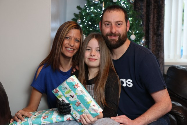 Lexi Pitchford,10, with her parents Lee and Emma Pitchford at home in Stoke on Trent.