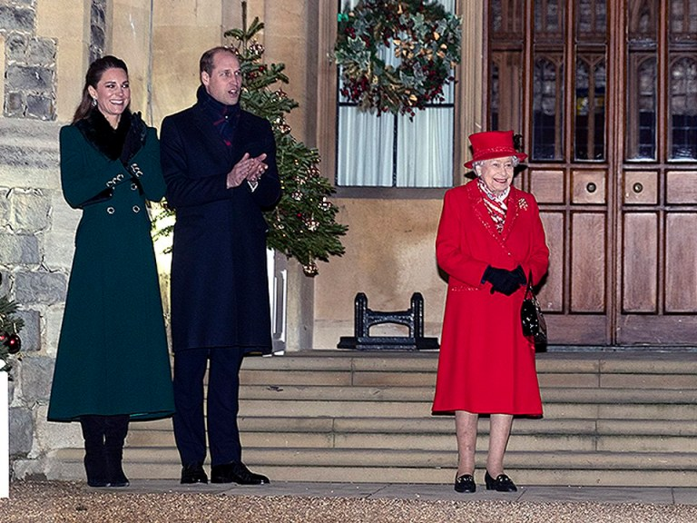 Queen Elizabeth II with Prince William, Duke of Cambridge and Catherine, Duchess of Cambridge during an event to thank local volunteers and key workers in the Quadrangle at Windsor Castle