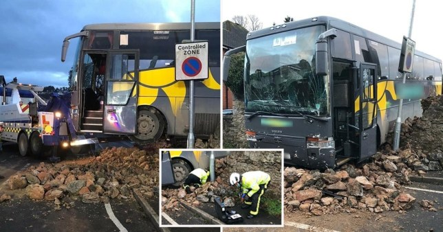 A school bus with 37 students on board has crashed through a wall in Newton Abbot, Devon this afternoon