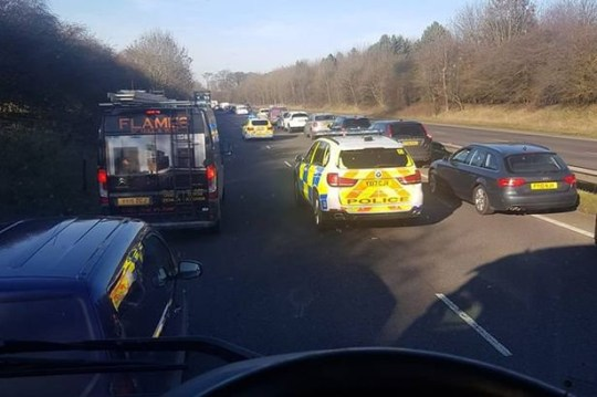 A teacher who ploughed into and killed a motorcyclist sat in a queue of traffic as police dealt with a fatal crash, was mentally distracted by a podcast, a court has heard. Jemma Rutherford, 24, of Goxhill admitted causing David Duckitt's death on the A15 on February 25 last year. Caption: A witness' picture shows police heading to the scene of the initial accident on the gridlocked A15