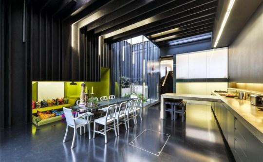 a dark brutalist kitchen