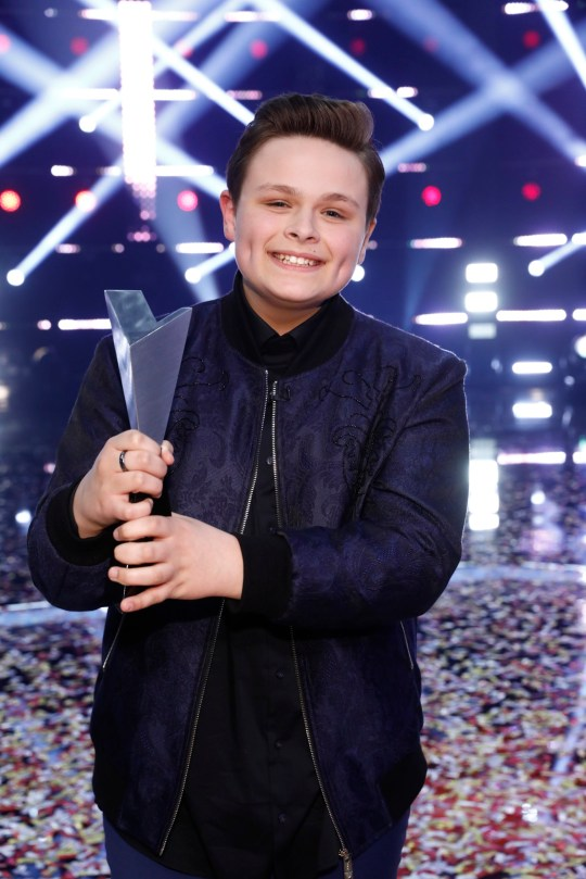 The Voice US winner Carter Rubin holds his trophy