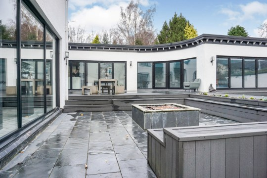 This luxurious five-bedroom Spanish-style villa with stunning Mediterranean architecture has sold for more than ??1,000,000 - in SHEFFIELD. See SWNS story SWLEvilla; The gorgeous property is reminiscent of a seaside mansion in a Costa Del Sol travel guide, with its magnificent arches, balconies and swimming pool. However, the breathtaking property is in fact situated in suburban South Yorkshire on the outskirts of Sheffield. The house is thought to have been erected in the 1970s and once had the hilarious name ???Costa Bomb??? - a comical nod to its Meditarrenean architecture and high price tag. Unfortunately a sign carrying the name was taken down some years ago after the dwelling was purchased by a new owner. Anyone interested in purchasing a slice of paradise will be left disappointed though as the property just sold for a whopping ??1,295,000 through estate agent Purple Brick.