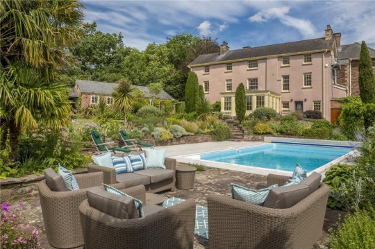 a pool outside a welsh mansion