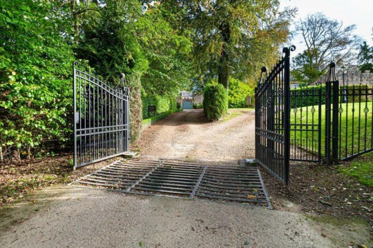 iron gates leading to castle coach house