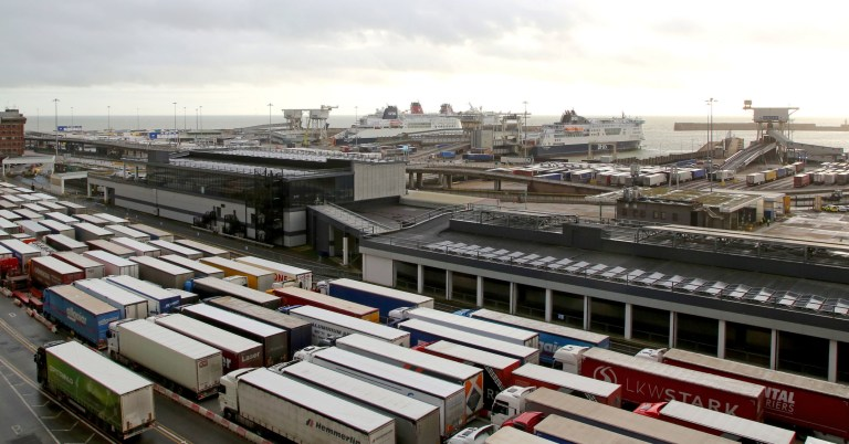Lorries queue to enter The Port of Dover in Kent as the clock ticks down on the chance for the UK to strike a deal before the end of the Brexit transition period on December 31. PA Photo. Picture date: Friday December 18, 2020. See PA story POLITICS Brexit Dover. Photo credit should read: Gareth Fuller/PA Wire