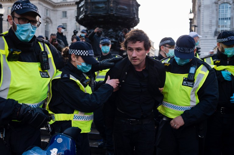 A man is arrested during an anti lockdown protest on December 19, 2020 in London, England. With the majority of the United Kingdom now under the strictest tier 3 lockdown, Prime Minister Boris Johnson is due to hold a press conference later in the day to update the public on advice around travel and gatherings at Christmas. (Photo by Maciek Musialek/NurPhoto)