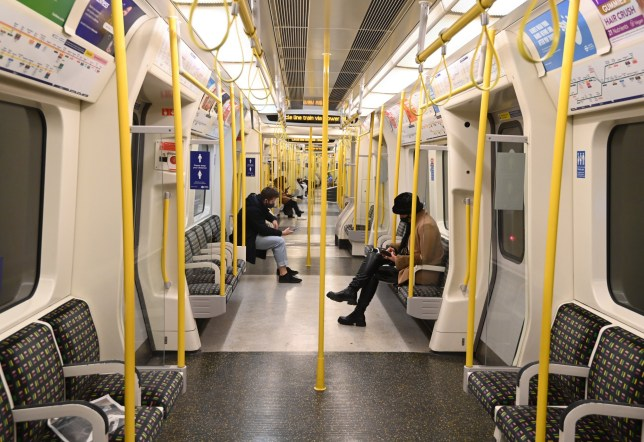 travellers on a london underground carriage