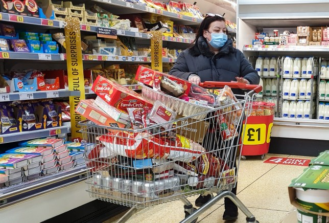? Licensed to London News Pictures. 21/12/2020. London, UK. Shoppers in Sainsbury?s supermarket in north London before 8am, buying festive groceries, just four days before Christmas day amid a French ban on British hauliers. France closed its border to UK travellers from 11pm last night as London, the South East of England and many parts of the UK went into Tier 4 lockdown as a new variant of the COVID19 virus continues to spread. Photo credit: Dinendra Haria/LNP