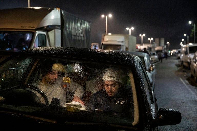 DOVER, ENGLAND - DECEMBER 22: Andre (R) and Constanti (L) from Romania wait in their car at the entry to the port on December 22, 2020 in Dover, England.