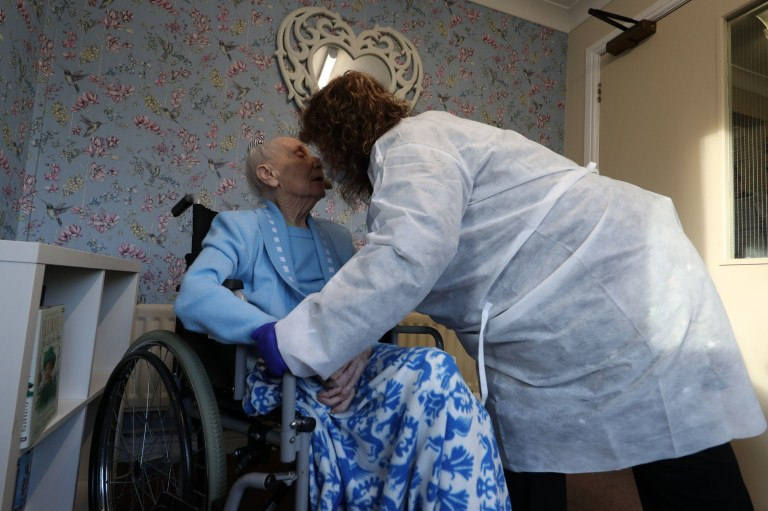 Diane Schofield embraces her friend Mary Kirby, who she affectionately calls Auntie Mary, during a Christmas Day visit at Aspen Hill Village care home in Hunslet, Leeds. The care home is able to host almost 50 visits for family members this Christmas after running successful trials of lateral flow testing for coronavirus. PA Photo. Picture date: Friday December 25, 2020. See PA story HEALTH Coronavirus. Photo credit should read: Danny Lawson/PA Wire