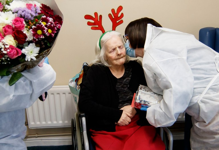 Mary Orme (right) and embraces her mother Rose McKimm, during a Christmas Day visit at Aspen Hill Village care home in Hunslet, Leeds. The care home is able to host almost 50 visits for family members this Christmas after running successful trials of lateral flow testing for coronavirus. PA Photo. Picture date: Friday December 25, 2020. See PA story HEALTH Coronavirus. Photo credit should read: Danny Lawson/PA Wire