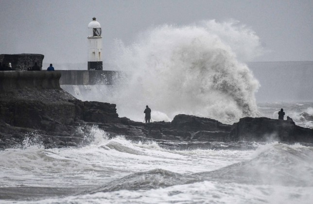 Mandatory Credit: Photo by Robert Melen/REX (11666009a) People watch as Storm Bella hits Porthcawl at high tide in Porthcawl, on Boxing Day evening as rain and strong winds effect parts of the UK. Storm Bella, Porthcawl, Wales, UK - 26 Dec 2020