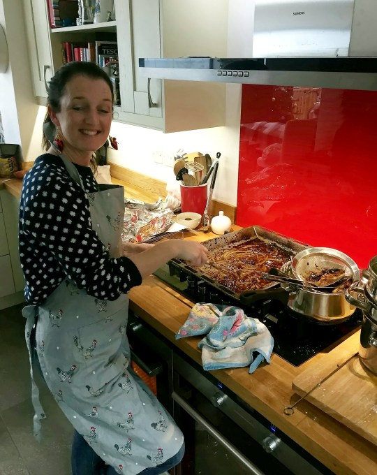 Sarah Govier cooking in kitchen