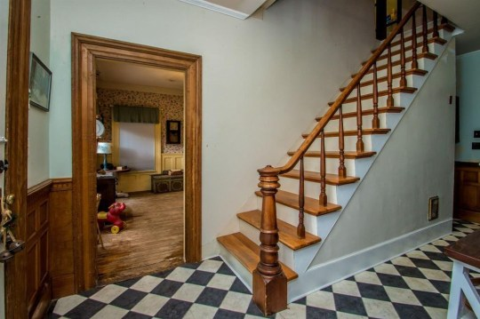 hallway of vermont cottage, staircase and black and white floors