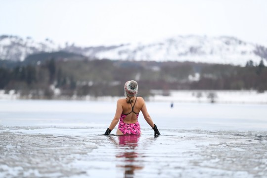 Nicky Goode stands in Loch Insh, Scotland, Britain December 30, 2020. REUTERS/Russell Cheyne