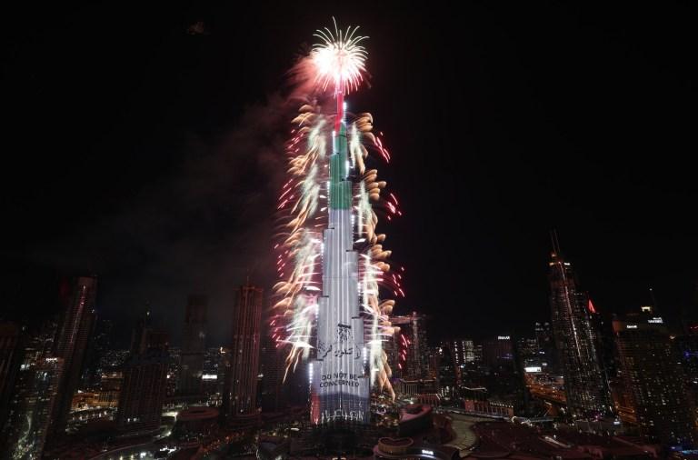 Fireworks illuminate the sky around Burj Khalifa,