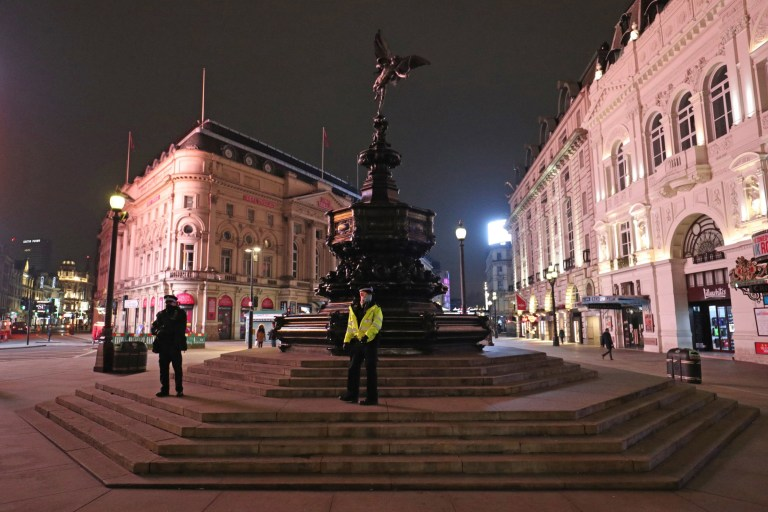 Police at the statue of Eros in Piccadilly Circus in London
